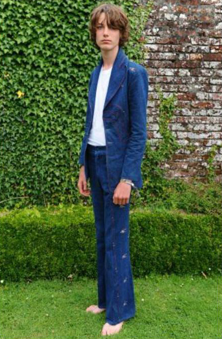 Model (Alex Stirling, who is a little small for the suit) in vintage denim Malcolm Hall suit, with small embroidered floral sprigs. Many thanks to Mark and Cleo Butterfield, of C20 Vintage Fashion, for their kind permission to use the image (taken at Port Eliot Festival, 2011)